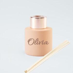 Rond parfumflesje blush met rosé gouden sluiting en geurstokjes